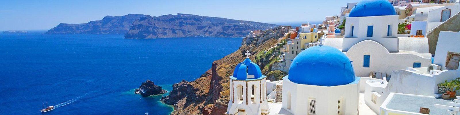 Santorini-caldera-oia-blue-domes-1600x500